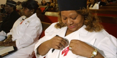 Congregants wearing AIDS ribbons at Black church service